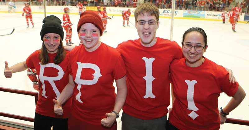 Students showing school spirit at a home hockey game